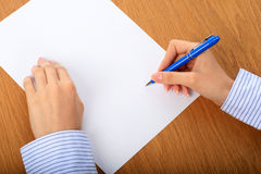Female hand signing contract. Royalty Free Stock Photo