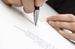Female hand signing a contract Royalty Free Stock Image