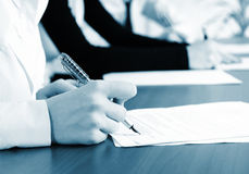 Female hand signing contract. Royalty Free Stock Photography