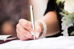 Business woman signing Stock Photography