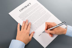 Female hand signs cooperation contract. Stock Photos