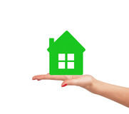 Female hand with small model of house isolated on white Royalty Free Stock Photo