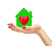 Female hand with small model of house with red heart isolated Stock Photo