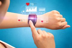 Cardio and smartwatch concept. Female hand with smartwatch and health application icons nearby Royalty Free Stock Photo