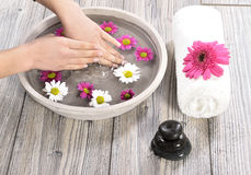 Female hand at spa salon on pedicure procedure Stock Photo