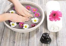 Female hand at spa salon on pedicure procedure Stock Photography