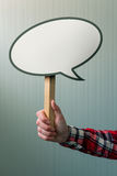 Female hand with speech bubble balloon as copy space Royalty Free Stock Image