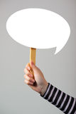 Female hand with speech bubble balloon as copy space Royalty Free Stock Photos