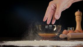 Female Hand Spilling Flour on the Table Royalty Free Stock Photos