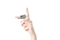 Female hand spining a key isolated on white background Royalty Free Stock Photos