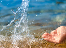 Female hand splashing clean water Royalty Free Stock Photos