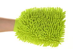 Female hand with a sponge mitt Stock Photos