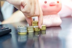 Female hand stack euro coins to shown concept of growing business and wealthy. Saving money concept stock photography