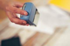 Female hand stamping document stock photo