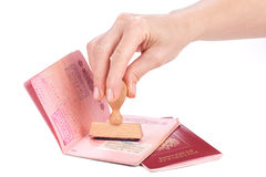 Female hand stamping a passport of Russia stock photos