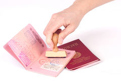 Female hand stamping a passport of the Soviet Union Royalty Free Stock Photography