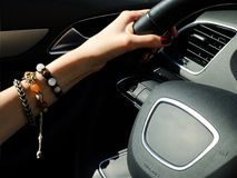 Female hand on the steering wheel Royalty Free Stock Images