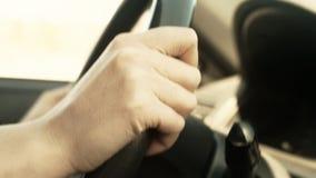 Female hand on steering wheel. stock footage