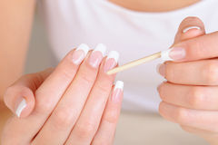 Female hand  with  stick for  cleaning cuticle Royalty Free Stock Photo