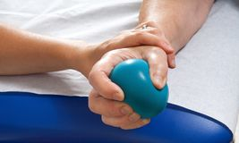 Hand with exercises putty manufacturer royalty free stock photo