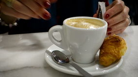 Female Hand Stirring Sugar into coffe latte. stock video