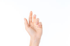 Female hand stretched up with fingers raised, isolated on white background Stock Photo