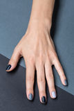 Female hand with a stylish neutral manicure Royalty Free Stock Photo