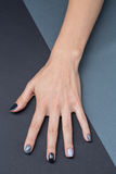 Female hand with a stylish neutral manicure Stock Images