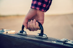 Female hand with suitcase Royalty Free Stock Images