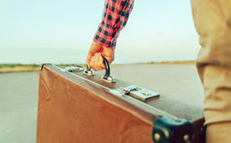 Female hand with suitcase handle Stock Image