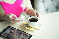 Female hand on the table, technology, internet, woman drinking coffee Royalty Free Stock Photo