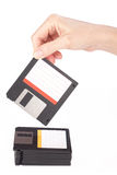 Female hand takes a floppy disk Stock Photography
