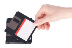 Female hand takes a floppy disk Royalty Free Stock Images
