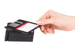 Female hand takes a floppy disk Royalty Free Stock Image