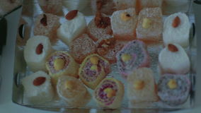 Female hand takes oriental sweets. East sweets of various kinds. Closeup. stock video footage