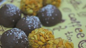 Female hand taking chocolate handmade candies, sweets festival, bakery. Stock footage stock video