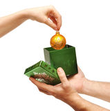Female hand taking christmas ball out of box Royalty Free Stock Images