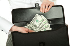 Female hand taking money out of briefcase Stock Photo