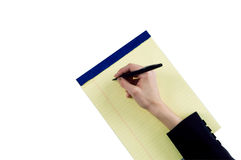 Female hand taking notes Royalty Free Stock Photography