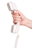 Hand with telephone receiver Royalty Free Stock Image