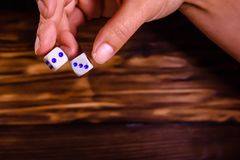 Female hand throwing dice. Gamble concept Royalty Free Stock Photography