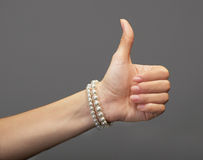 Female hand with a thumb up Royalty Free Stock Photography