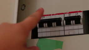 Female hand toggle switch in the switch box, All switches being turned on and off. Electricity, power stock footage