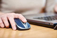 Female hand touching computer mouse Royalty Free Stock Photography