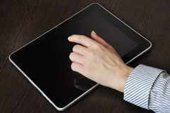 Female hand touching screen of tablet pc Royalty Free Stock Image
