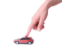 Female hand and the toy car Stock Photos