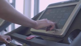 Female hand on the treadmill monitor stock footage