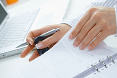 Female hand turning page Royalty Free Stock Photo