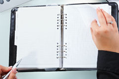 Female hand turning page stock photography