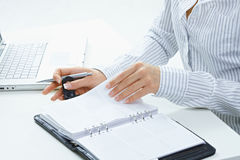 Female hand turning page Royalty Free Stock Photos